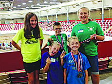 "<div class=""source"">Submitted photo</div><div class=""image-desc"">LaRue County 4-H members brought home several honors in the 4-H Livestock Skillathon in Bowling Green. Pictured are front from left, Lexi Grimes and Makenzie Hornback; back, Abby Hazelwood, Kaleb Miller and Kalli Flanders.  </div><div class=""buy-pic""><a href=""/photo_select/29883"">Buy this photo</a></div>"