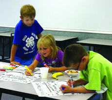 """<div class=""""source"""">Submitted photo </div><div class=""""image-desc"""">Daniel Allen, Addison White and Lincoln Miller participated in the September 4-H Cloverbuds meeting. Cloverbud activities are held monthly for 5-8 year olds. Contact 4-H Agent Misty Wilmoth at 358-3401 for more information or to sign your child up to participate.</div><div class=""""buy-pic""""><a href=""""/photo_select/30273"""">Buy this photo</a></div>"""