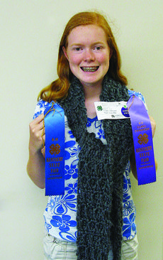 """<div class=""""source"""">Submitted photo</div><div class=""""image-desc"""">Leslie Pike was awarded Class Champion in the 4-H Novelty Yarn Crochet Division at the Kentucky State Fair.    </div><div class=""""buy-pic""""><a href=""""http://web2.lcni5.com/cgi-bin/c2newbuyphoto.cgi?pub=029&orig=4h_leslie_pike.jpg"""" target=""""_new"""">Buy this photo</a></div>"""