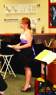 """<div class=""""source"""">Submitted photo</div><div class=""""image-desc"""">Above, Addie Cundiff presented some of her own poems, during the  coffeehouse event. Cundiff was one of five  ALES students that presented their poems for family and friends. </div><div class=""""buy-pic""""><a href=""""/photo_select/27744"""">Buy this photo</a></div>"""
