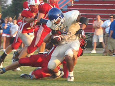"""<div class=""""source"""">Mark Bandurske</div><div class=""""image-desc"""">LaRue's Alex Lee drags several Nelson County defenders down the field for yardage last Friday in a preseason scrimmage. The Hawks have their season opener this Saturday at Campbellsville.</div><div class=""""buy-pic""""><a href=""""/photo_select/2388"""">Buy this photo</a></div>"""
