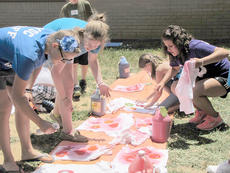 "<div class=""source"">Ron Benningfield</div><div class=""image-desc"">COOL School students Maddie Lee, Hannah Keith, and Airyl Heath help teacher Cara Holt lay out solar flare t-shirts they made at Hodgenville Elementary School last week. A group of Beta students are helping Ms. Holt lay out the solar flare t-shirts that the COOL School Students made.  Beta members are:  Maddie Lee, Hannah Keith and Airyl Heath.</div><div class=""buy-pic""><a href=""http://web2.lcni5.com/cgi-bin/c2newbuyphoto.cgi?pub=029&orig=COOLSchool%2B2012%2B052.jpg"" target=""_new"">Buy this photo</a></div>"
