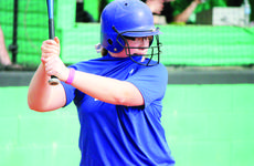 """<div class=""""source"""">David Dawson</div><div class=""""image-desc"""">Lady Hawk Emilee Cundiff concentrated by taking a nip of her own shirt while at bat.</div><div class=""""buy-pic""""><a href=""""/photo_select/26934"""">Buy this photo</a></div>"""
