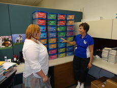 """<div class=""""source""""></div><div class=""""image-desc"""">Katie Wheatley, LaRue County Public Library children's librarian, and Sarah Hornback, right, discuss the literacy kits the LaRue County Community Early Childhood Council recently purchased for the library.</div><div class=""""buy-pic""""><a href=""""/photo_select/21362"""">Buy this photo</a></div>"""