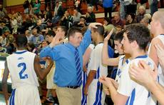 """<div class=""""source"""">Richard RoBards</div><div class=""""image-desc"""">Coach Paul Childress congratulated his players after a 10-point win over Green County.</div><div class=""""buy-pic""""><a href=""""/photo_select/7635"""">Buy this photo</a></div>"""