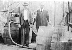 """<div class=""""source"""">Submitted photo</div><div class=""""image-desc"""">DeLime and Soup Boone posed with a moonshine still. </div><div class=""""buy-pic""""><a href=""""/photo_select/29966"""">Buy this photo</a></div>"""