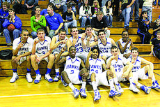"<div class=""source""></div><div class=""image-desc"">The varsity Hawks celebrated after clinching the 18th District basketball championship Saturday with a win over Green County 55-48.</div><div class=""buy-pic""><a href=""/photo_select/903"">Buy this photo</a></div>"