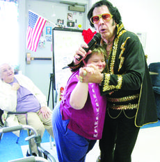 "<div class=""source""></div><div class=""image-desc"">Angela Smith is being serenaded by Elvis while dancing.</div><div class=""buy-pic""><a href=""http://web2.lcni5.com/cgi-bin/c2newbuyphoto.cgi?pub=029&orig=Elvis%2BComes%2BTo%2BTown%2B040.jpg"" target=""_new"">Buy this photo</a></div>"