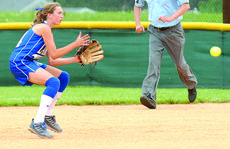 """<div class=""""source"""">Jill Pickett</div><div class=""""image-desc"""">LaRue County's Erin Boley fielded the ball during the game against Elizabethtown's Lady Panthers.</div><div class=""""buy-pic""""><a href=""""/photo_select/11405"""">Buy this photo</a></div>"""