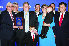 """<div class=""""source""""></div><div class=""""image-desc"""">Ryan and Misty Bivens, center, with sons Cyrus and Avery, received the 2012 Outstanding Young Farm Family award during Kentucky Farm Bureau's annual meeting in Louisville. Presenting the award are Mark Haney, KFB President, left, and David S. Beck, KFB Executive Vice President, right.</div><div class=""""buy-pic""""></div>"""