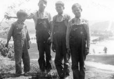"""<div class=""""source"""">Submitted photo</div><div class=""""image-desc"""">Bill Boone shares this photo of Garland, Adolph, Irvine and Jimmy Boone. It was taken in 1937 after a flood in Howardstown.</div><div class=""""buy-pic""""><a href=""""http://web2.lcni5.com/cgi-bin/c2newbuyphoto.cgi?pub=029&orig=Garland%2BAdolph%2BIrvine%2Band%2BJimmy%2BBoone%2Bcousins%2Bat%2BChurch%2BPoint%2Bafter%2Bflood%2Bin%2B1937.jpg"""" target=""""_new"""">Buy this photo</a></div>"""