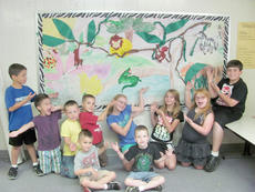 """<div class=""""source""""></div><div class=""""image-desc"""">Students in Mrs. Holt's Art Class, at Kids Crew worked together to create the artwork shown, as part of their lesson on murals. Students were able to make connections to what they knew of murals from their elementary schools, and the public library to create this jungle scene. Kids Crew is sponsored by the United Way and has a variety of classes such as: Art, Music, Tae Kwon Do,  and they also participate in the summer reading program at the public library, and have many field trips planned for the summer around the state. </div><div class=""""buy-pic""""><a href=""""/photo_select/21649"""">Buy this photo</a></div>"""