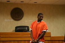 """<div class=""""source"""">Linda Ireland</div><div class=""""image-desc"""">Abdullah White looked over the LaRue County District Courtroom Wednesday before his arraignment. White was indicted for theft and burglary Monday, Jan. 9.</div><div class=""""buy-pic""""><a href=""""/photo_select/18614"""">Buy this photo</a></div>"""