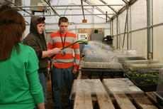 """<div class=""""source"""">Linda Ireland</div><div class=""""image-desc"""">LaRue County High School agriculture student David Maggard sprayed plant trays inside the school's greenhouse with water. Ben Page is at right.</div><div class=""""buy-pic""""><a href=""""/photo_select/19277"""">Buy this photo</a></div>"""