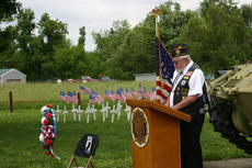 """<div class=""""source"""">Linda Ireland</div><div class=""""image-desc"""">Tom McGrew of American Legion Post 87 in Hodgenville read the names of fallen soldiers in foreign wars.</div><div class=""""buy-pic""""><a href=""""http://web2.lcni5.com/cgi-bin/c2newbuyphoto.cgi?pub=029&orig=IMG_3440.JPG"""" target=""""_new"""">Buy this photo</a></div>"""