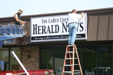 "<div class=""source"">Bud Ireland</div><div class=""image-desc"">Workers from Rodgers Sign Service in Elizabethtown installed a new sign Friday morning for The LaRue County Herald News.</div><div class=""buy-pic""><a href=""http://web2.lcni5.com/cgi-bin/c2newbuyphoto.cgi?pub=029&orig=IMG_3572.JPG"" target=""_new"">Buy this photo</a></div>"