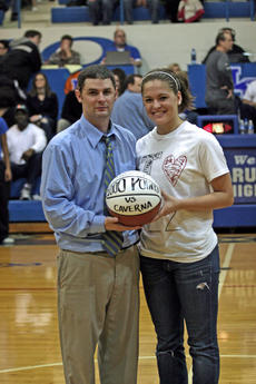 """<div class=""""source"""">Terry Sandidge</div><div class=""""image-desc"""">Senior Lady Hawk Valerie Whitlock was presented a basketball representing her 1,000th career point against Caverna. Her coach, Travis Wootton, is at left.</div><div class=""""buy-pic""""><a href=""""/photo_select/13094"""">Buy this photo</a></div>"""