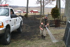 """<div class=""""source"""">Linda Ireland</div><div class=""""image-desc"""">LaRue County firefighters Eric Clark, in truck, and Michael Key extinguish the remnants of a field fire that broke out between Buffalo and Mount Sherman Thursday.</div><div class=""""buy-pic""""><a href=""""/photo_select/13353"""">Buy this photo</a></div>"""