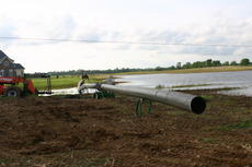 """<div class=""""source"""">Linda Ireland</div><div class=""""image-desc"""">Workers are fusing 18-inch pipes that will carry water away from Walter Reed Road.</div><div class=""""buy-pic""""><a href=""""/photo_select/14489"""">Buy this photo</a></div>"""