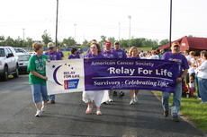 "<div class=""source"">Linda Ireland</div><div class=""image-desc"">Cancer survivors carried the Relay for Life banner during opening ceremony Friday evening.</div><div class=""buy-pic""><a href=""/photo_select/11204"">Buy this photo</a></div>"