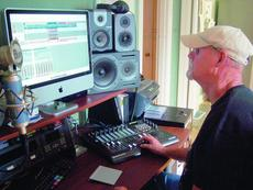 """<div class=""""source"""">Ron Benningfield</div><div class=""""image-desc"""">Jerry Williams uses his computer program to create CDs in his home studio in Hodgenville.</div><div class=""""buy-pic""""><a href=""""http://web2.lcni5.com/cgi-bin/c2newbuyphoto.cgi?pub=029&orig=Jerry%2BWilliams.jpg"""" target=""""_new"""">Buy this photo</a></div>"""