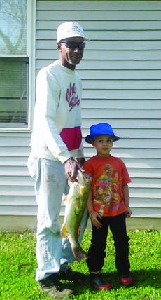 """<div class=""""source"""">Submitted photo</div><div class=""""image-desc"""">Kanaan Hillard, 4, caught an 8-pound bass on May 12. He was assisted by his grandfather, Norman Handley.</div><div class=""""buy-pic""""><a href=""""/photo_select/27733"""">Buy this photo</a></div>"""