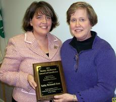 """<div class=""""source"""">Ronnie Benningfield</div><div class=""""image-desc"""">At left, Joanna Hinton of Hinton's Orchard, a member of the LaRue County Extension  Council, presents the 2012 Bobby McDowell Award of Excellence to Kathy Ross.</div><div class=""""buy-pic""""><a href=""""/photo_select/18772"""">Buy this photo</a></div>"""