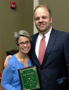"""<div class=""""source""""></div><div class=""""image-desc"""">Katy Cecil, 2013 Kentucky National Forensic League Coach of the Year, is pictured with Kentucky NFL District Chairman Steve Meadows of Danville High School.</div><div class=""""buy-pic""""><a href=""""/photo_select/26789"""">Buy this photo</a></div>"""