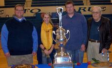 "<div class=""source"">Ron Benningfield</div><div class=""image-desc"">Standing behind LaRue County High School's state championship marching band trophy are, from left, Jaime Smith, director; Natalie Walker, color guard choreographer/instructor; Mike Collins, assistant band director and Gene Hoggard, director emeritus. John Harris, percussion instructor, was in New York when the picture was taken.</div><div class=""buy-pic""><a href=""http://web2.lcni5.com/cgi-bin/c2newbuyphoto.cgi?pub=029&orig=LCHS%2BBand%2Bdirector%2Band%2Bassistants.jpg"" target=""_new"">Buy this photo</a></div>"