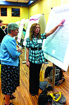 """<div class=""""source""""></div><div class=""""image-desc"""">Laura Bishop, right, a senior from Greensburg, shows her poster to Brenda Tungate, associate professor of biology at Campbellsville University, at the KAS conference.</div><div class=""""buy-pic""""></div>"""