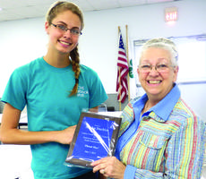 """<div class=""""source"""">Submitted photo</div><div class=""""image-desc"""">Alisha Durbin, left, receives a plaque from L.A.C.E council president Rita Williams for her service as a student representative on the council the past two years. </div><div class=""""buy-pic""""><a href=""""/photo_select/27933"""">Buy this photo</a></div>"""