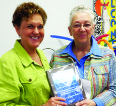 """<div class=""""source"""">Submitted photo</div><div class=""""image-desc"""">Rita Williams, right, L.A.C.E. council president, presents the Judy Cox Community Spirit Award to Pam Bowling. </div><div class=""""buy-pic""""><a href=""""/photo_select/27938"""">Buy this photo</a></div>"""