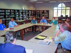 """<div class=""""source"""">Ron Benningfield</div><div class=""""image-desc"""">Superintendent Sam Sanders, right, discusses the laptop initiative with a committee composed of members of the community, students and school personnel.</div><div class=""""buy-pic""""><a href=""""/photo_select/5319"""">Buy this photo</a></div>"""