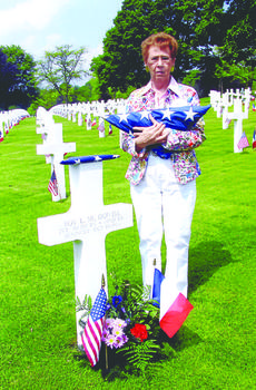 """<div class=""""source""""></div><div class=""""image-desc"""">Ruby Heady stands beside the grave of her father, Pvt. Roy E. McDowell, killed in combat in 1944 and buried in France.</div><div class=""""buy-pic""""><a href=""""http://web2.lcni5.com/cgi-bin/c2newbuyphoto.cgi?pub=029&orig=Ruby%2BHeady.jpg"""" target=""""_new"""">Buy this photo</a></div>"""