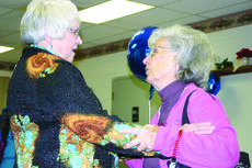 "<div class=""source"">Linda Ireland</div><div class=""image-desc"">Emogene Gardner gives Beverly Heath a hug at her retirement party.</div><div class=""buy-pic""><a href=""/photo_select/25116"">Buy this photo</a></div>"