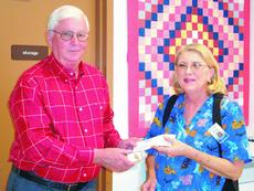 """<div class=""""source""""></div><div class=""""image-desc"""">Diane Curry received her 25-year service award from Sunrise Manor Nursing Home Chairman of the Board Rondal Wright.</div><div class=""""buy-pic""""><a href=""""/photo_select/12129"""">Buy this photo</a></div>"""