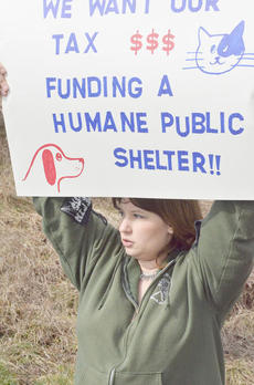 """<div class=""""source"""">Calen McKinney</div><div class=""""image-desc"""">Tuesday's protest was also a rally to adopt the animals at the shelter. About half were taken to new homes. Shawn Moffitt held a sign.</div><div class=""""buy-pic""""><a href=""""http://web2.lcni5.com/cgi-bin/c2newbuyphoto.cgi?pub=029&orig=Shelter%2BProtest%2B7_0.jpg"""" target=""""_new"""">Buy this photo</a></div>"""