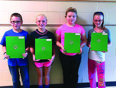 """<div class=""""source""""></div><div class=""""image-desc"""">4-H Club officers for Abraham Lincoln Elementary School fifth grade in Hynes, Rogers and Cecil's class are president, Biven Turner; vice president, Katelyn Eads; secretary, Abi Gibson; and reporter, Mallory Skaggs.</div><div class=""""buy-pic""""><a href=""""/photo_select/31159"""">Buy this photo</a></div>"""