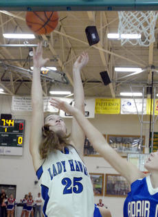 "<div class=""source"">Jill Pickett</div><div class=""image-desc"">LaRue County's Alley Evans shoots over Adair County's Alex Keltner during a Girls' 5th Region Basketball Tournament quarterfinal game Wednesday at Green County High School in Greensburg.</div><div class=""buy-pic""><a href=""/photo_select/26175"">Buy this photo</a></div>"