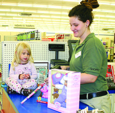 "<div class=""source"">Linda Ireland</div><div class=""image-desc"">Anaka Phillip, the 3-year-old daughter of Jessica Phillip and David Skaggs, was the girls' winner of The LaRue County Herald News Santa Letter drawing. Anaka chose a doll, princess lip balm and a unicorn flashlight for her gifts. Althea Freeman is the checker.</div><div class=""buy-pic""><a href=""/photo_select/24890"">Buy this photo</a></div>"