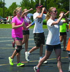 """<div class=""""source"""">Photo by Rebecca Roscoe</div><div class=""""image-desc"""">Drum major Lauren Zahrndt taps out the rhythm to help set the pace during a marching exercise during band camp on July 24.  </div><div class=""""buy-pic""""><a href=""""/photo_select/29295"""">Buy this photo</a></div>"""