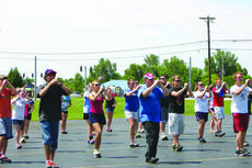 """<div class=""""source""""></div><div class=""""image-desc"""">Members of the LaRue County High School Band of Hawks work on getting their toes up high as they participate in drill practice.  </div><div class=""""buy-pic""""><a href=""""/photo_select/29296"""">Buy this photo</a></div>"""