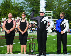 "<div class=""source"">Submitted photo</div><div class=""image-desc"">From left, colorguard members Morgan Humphrey and Kayleigh Warren, Drum Major Lauren Zahrndt and Olivia Litton, percussion section leader, stood with their trophies won at Bourbon County. </div><div class=""buy-pic""></div>"