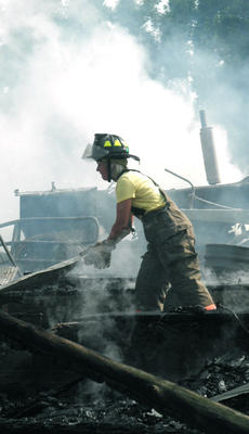 "<div class=""source"">Candis Carpenter</div><div class=""image-desc"">LaRue, Buffalo and Magnolia firefighters were dispatched to the scene of a barn fire on Stiles Ford Road June 17. Above, LaRue County firefighter Jo Mather moves debris to make sure there were no live embers underneath.</div><div class=""buy-pic""><a href=""http://web2.lcni5.com/cgi-bin/c2newbuyphoto.cgi?pub=029&orig=barn%2Bfire.jpg"" target=""_new"">Buy this photo</a></div>"