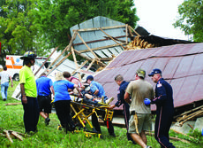 "<div class=""source"">Photo by Linda Ireland</div><div class=""image-desc"">LaRue County EMS, Air Methods paramedics and volunteer firefighters accompany 48-year-old Carmello Mullion to a medical helicopter after freeing him from a collapsed tobacco barn.</div><div class=""buy-pic""><a href=""/photo_select/30408"">Buy this photo</a></div>"