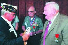 """<div class=""""source"""">Neal Cardin</div><div class=""""image-desc"""">Dave Jarrett, left, hands documents to World War II veterans Blond Puckett and James Calvin Sarver after the pair were awarded the French Legion of Honor medals Thursday for helping liberate the country from the Nazi regime. The ceremony took place at Pri</div><div class=""""buy-pic""""><a href=""""http://web2.lcni5.com/cgi-bin/c2newbuyphoto.cgi?pub=029&orig=blond%2Bpuckett.jpg"""" target=""""_new"""">Buy this photo</a></div>"""