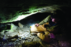 "<div class=""source"">Natasha Khan / PublicSource</div><div class=""image-desc"">Nolen Boone's family has owned his 120-acre farm in New Haven, Ky., for generations. Boone crawls around a cave that spiders for a mile under his property and that of two of his neighbors.</div><div class=""buy-pic""></div>"