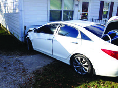 """<div class=""""source"""">Submitted photo</div><div class=""""image-desc"""">A Hyundai Sonata, driven by James Brewer, ran into a house on Ferrill Hill Sunday, after colliding with another vehicle. </div><div class=""""buy-pic""""><a href=""""http://web2.lcni5.com/cgi-bin/c2newbuyphoto.cgi?pub=029&orig=boo_brewer_car.jpg"""" target=""""_new"""">Buy this photo</a></div>"""