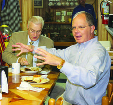"""<div class=""""source"""">Linda Ireland</div><div class=""""image-desc"""">U.S. Representative Brett Guthrie spoke with supporters at Paula's Hot Biscuit in Hodgenville.</div><div class=""""buy-pic""""><a href=""""/photo_select/38265"""">Buy this photo</a></div>"""
