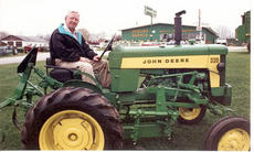 "<div class=""source""></div><div class=""image-desc"">Joseph Burks is pictured here on a John Deere tractor in front of his store.</div><div class=""buy-pic""></div>"